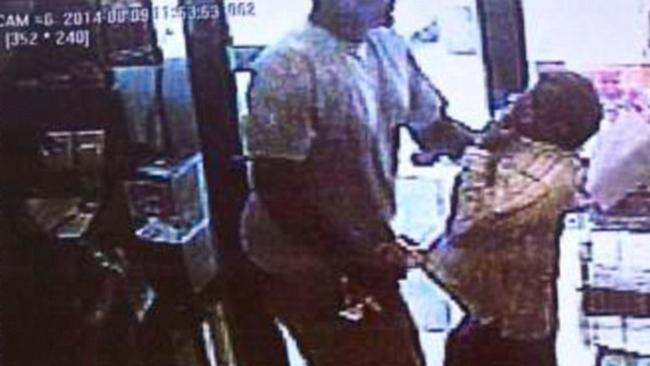 """Family angered ... Police released CCTV images of a """"strong-armed"""" robbery, naming Michael Brown as teh chief suspect."""