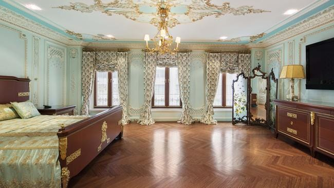 The main bedroom in the New York apartment is huge and finished in an opulent style. Picture: Warburg Realty.