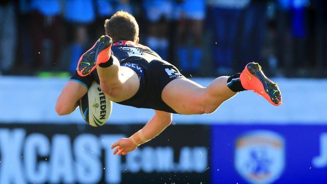 Matt Moylan dives in for an athletic try.