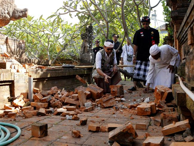 Locals assess the damage at a Bali temple. Picture: Firdia Lisnawati/AP