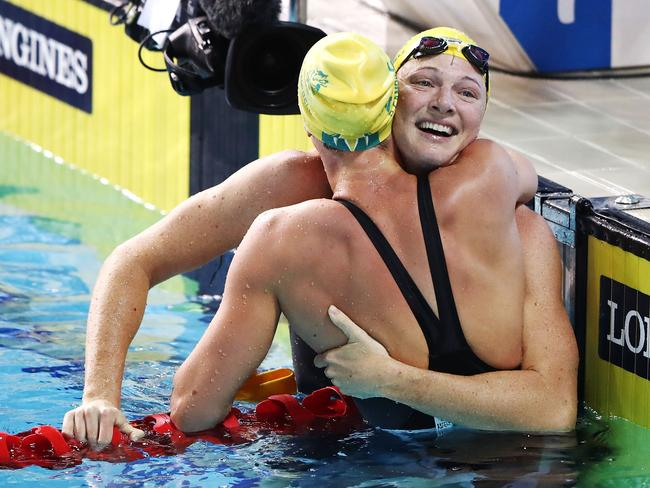 Cate Campbell, who has already won three gold medals this Commonwealth Games, congratulates sister Bronte following her upset win in the women's 100 metres freestyle. Picture: Hannah Peters/Getty Images