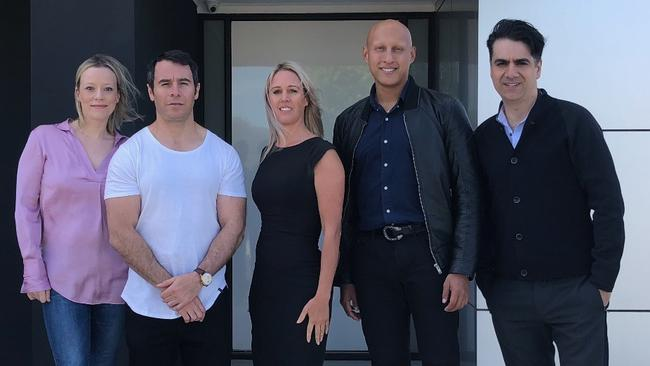 Pictured at the front of the house are, from left, Owners Nicole and Zlatko Nedanovski, Haven The Agency director Rachael Lay, NK Foundation chief executive Christos Kyrgios, New Wave Corporation director and builder Kosta Dimitrakis.
