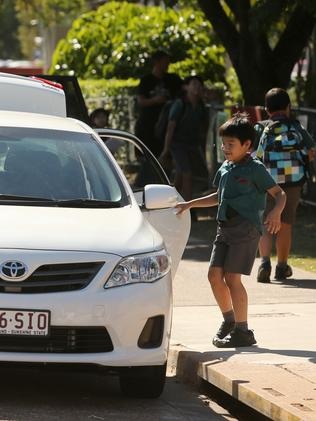 Pick up and drop off zone at MacGregor Primary School. Picture: Jono Searle