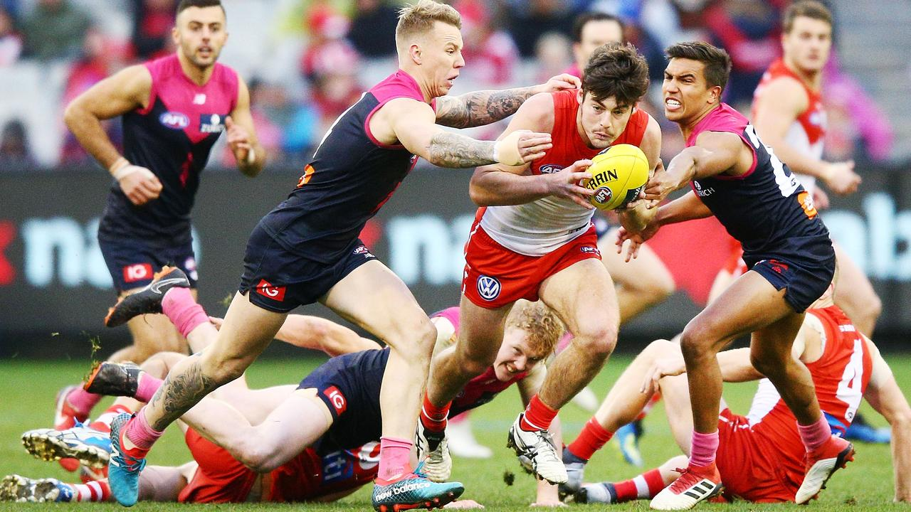 James Harmes chases down Sydney midfielder George Hewett last season.