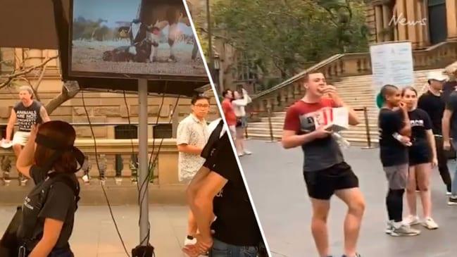 Man eats KFC in front of vegan activist group