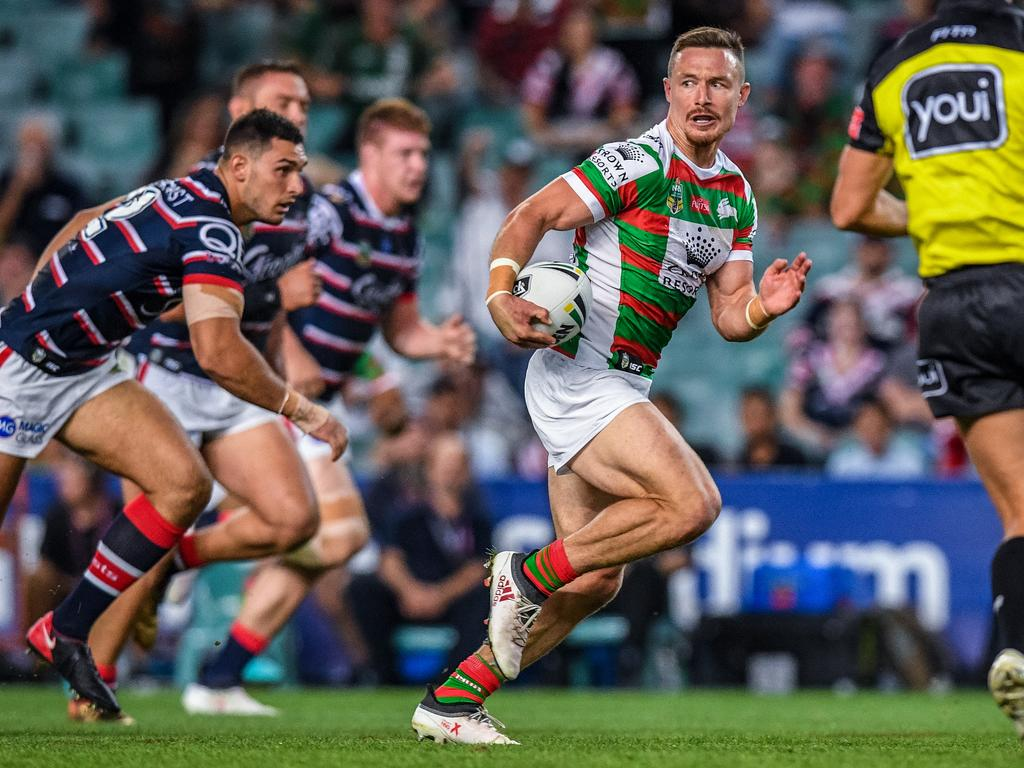 Damien Cook for the Rabbitohs runs away from Ryan Matterson.