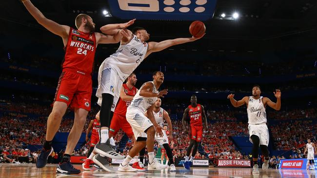 Matthew Hodgson of the Bullets wins a rebound against Jesse Wagstaff of the Wildcats. Picture: Getty Images