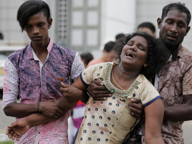 Relatives of a blast victim grieve outside a morgue in Colombo, Sri Lanka. Picture: Eranga Jayawardena/AP