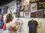 Robyn Atkinson-Dunn, a tourist from Salt Lake City stops at a pop-up t-shirt shop to buy an eclipse themed t-shirt on August 19, 2017 in Rexburg, Idaho. Picture: Natalie Behring/Getty Images/AFP