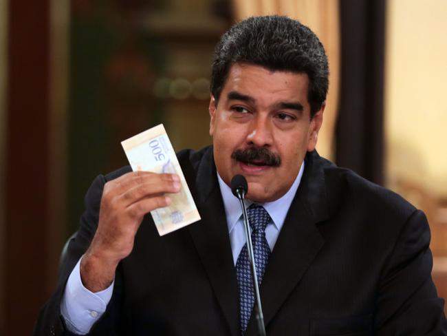 President Nicolas Maduro showing off the fresh currency. Picture: AFP