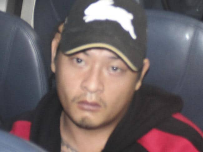 Transfer to island ... Bali Nine ringleader Andrew Chan on the plane from Bali to Cilacap.