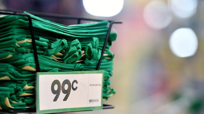 Woolworths says sales slowed because of the plastic bag ban.