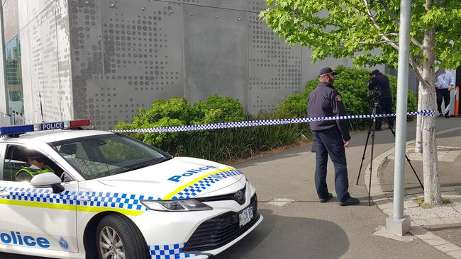 Police investigating the discovery of a body in bushes near the Royal Hobart Hospital's Emergency Department ramp on the corner of Campbell and Liverpool streets. Picture: SHAUN McMANUS