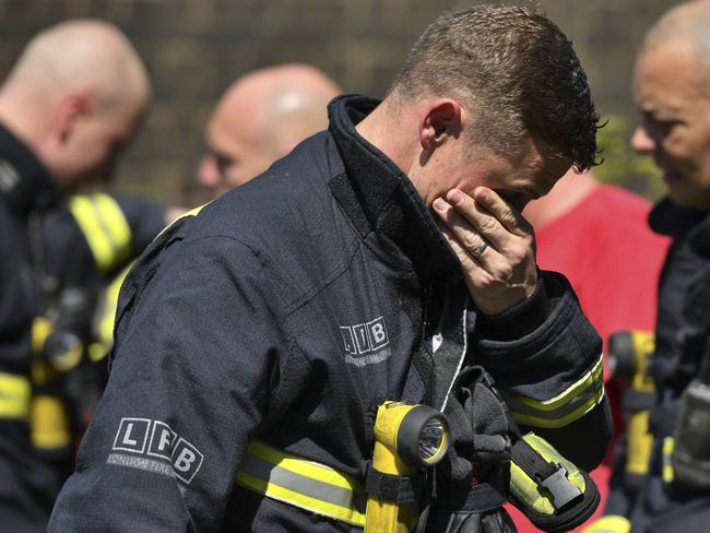 Firefighters have struggled to access the top floors of the charred building. Picture: Dominic Lipinski/PA via AP