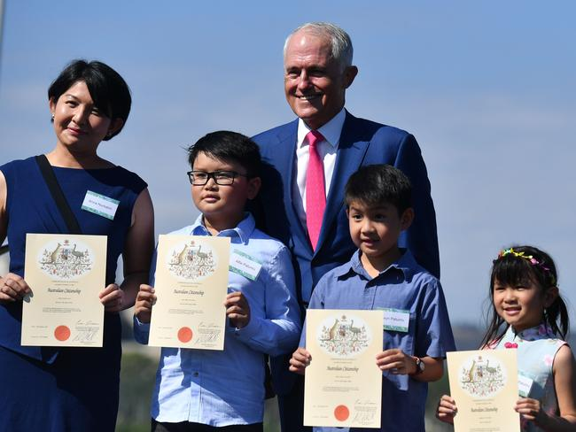 Prime Minister Malcolm Turnbull poses with new Australian citizens at an Australia Day Citizenship Ceremony and Flag Raising event in Canberra. Picture: AAP