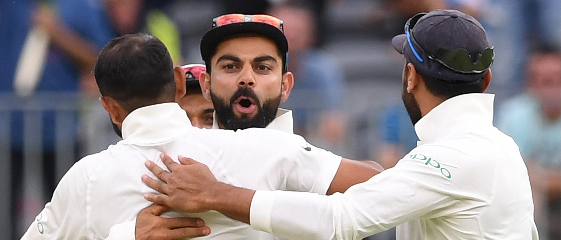 Indian captain Virat Kohli reacts after the dismissal of Australian batsman Travis Head  on day three of the second Test match between Australia and India at Perth Stadium in Perth, Sunday,  December 16,  2018.  (AAP Image/Dave Hunt) NO ARCHIVING, EDITORIAL USE ONLY, IMAGES TO BE USED FOR NEWS REPORTING PURPOSES ONLY, NO COMMERCIAL USE WHATSOEVER, NO USE IN BOOKS WITHOUT PRIOR WRITTEN CONSENT FROM AAP