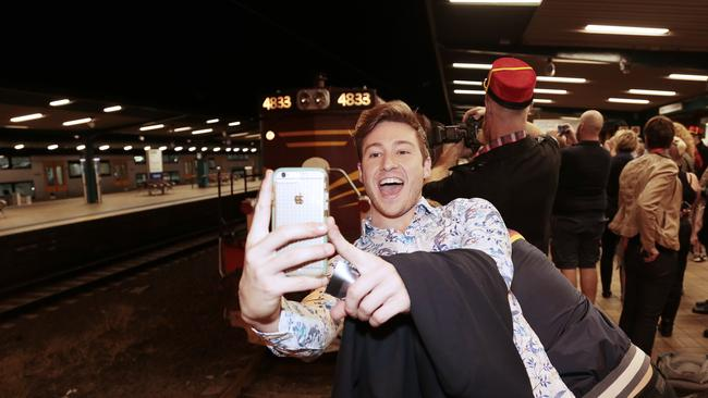 All aboard ... Matt Mitcham takes a selfie as the train rolls in to Central. Photographer: Adam Yip