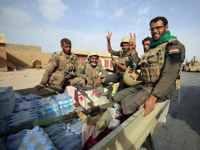 Iraqi forces and members of the Hashed al-Shaabi (Popular Mobilisation units) fighting IS. Picture: AFP