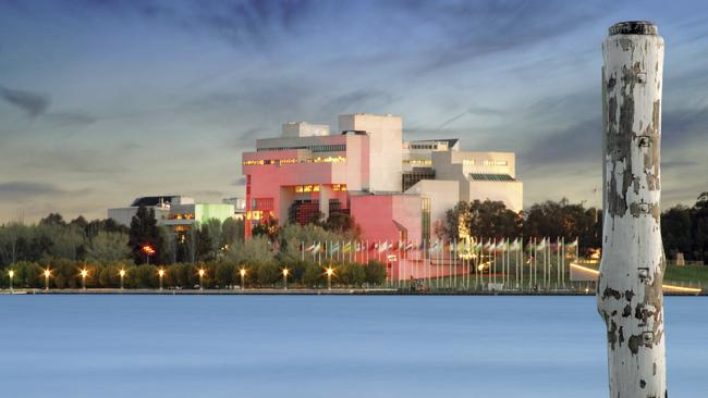 Exterior of the High Court of Australia as seen from the shore of Lake Burley Griffin in Canberra.
