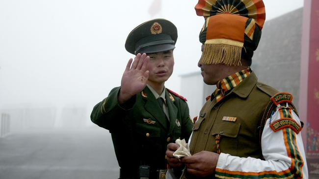 Chinese and Indian soldiers at the Nathu La border crossing. Picture: AFP