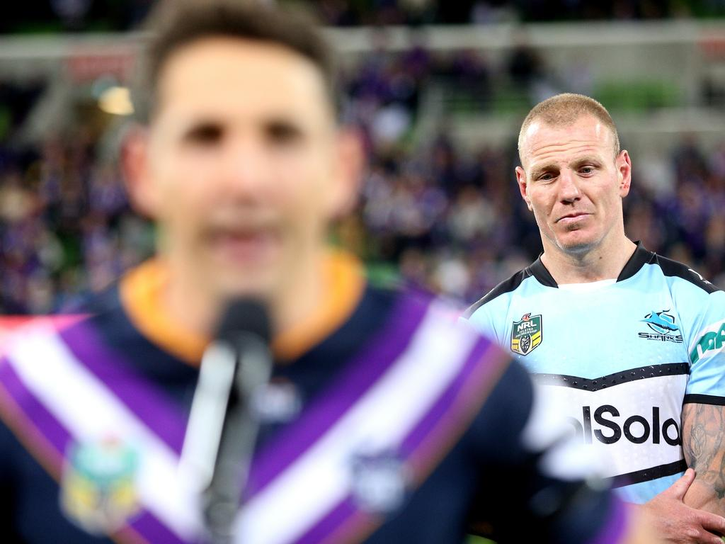 Luke Lewis of the Sharks watches Billy Slater of the Storm makes a speech after the Preliminary Final match between the Melbourne Storm and the Cronulla-Sutherland Sharks at AAMI Park in Melbourne, Friday, September 21, 2018. (AAP Image/Hamish Blair) NO ARCHIVING, EDITORIAL USE ONLY