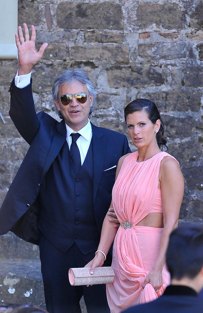 Guests arrive in Florence for Kim Kardashian and Kanye West's wedding. Pictured: Veronica Berti and Andrea Bocelli