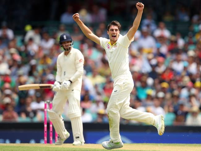 Pat Cummins celebrates after taking the wicket of James Vince.