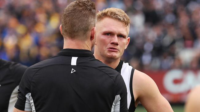 Adam Treloar and Collingwood coach Nathan Buckley after the Grand Final. Pic: Phil Hillyard