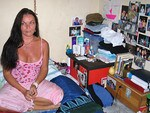 Schapelle Corby in her cell in Bali. Pictures of her loved ones are displayed.