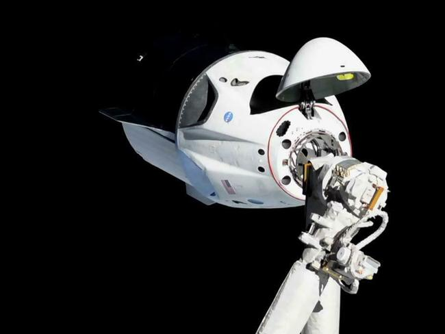 In this, March 3, 2019 file photo provided by NASA, the SpaceX Crew Dragon capsule is pictured about 20 meters away from the International Space Station's Harmony module.