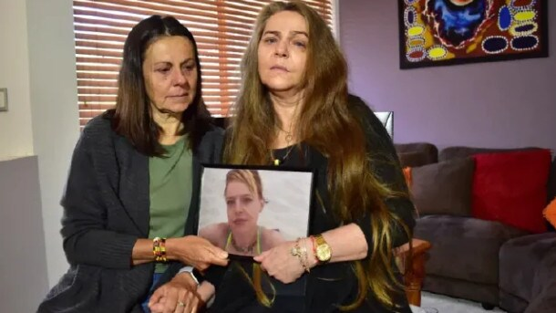 Kym Taylor's mother, Courtney Hill-Aaron, right, and her aunt Leanne Taylor, holding a picture of Kym Taylor, 37, whose body was found in bushland near Perth on Sunday morning.