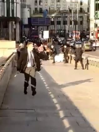 The video showed a crowd of people jumping into a man. Picture: Twitter