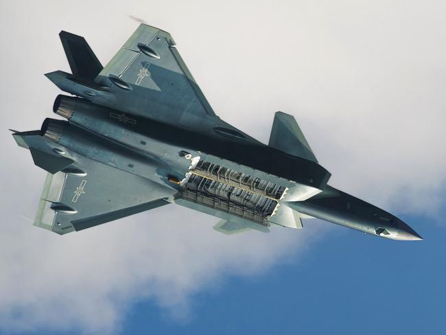A J-20 reveals its extensive internal main weapons bay.