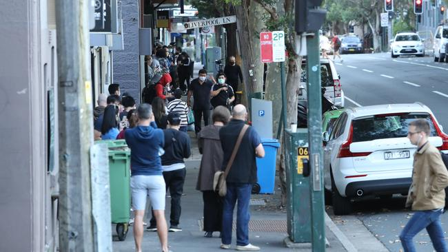 A long queue outside the Darlinghurst Centrelink office in Sydney early on Tuesday, long before the office was due to open. Picture: Rohan Kelly