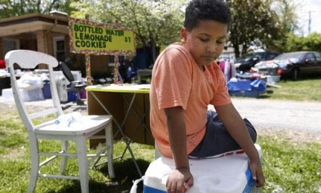 Boy sells homemade lemonade to pay for his own adoption fees