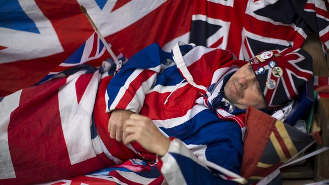 Royal fan ... John Loughrey, 60, has been sleeping across the street from St Mary's Hospital, where Kate will give birth. Picture: AP