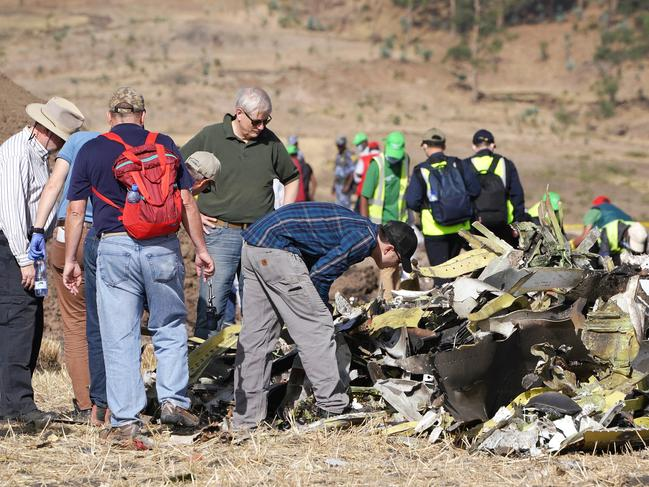Investigators with the US National Transportation and Safety Board (NTSB) look over debris at the crash site of Ethiopian Airlines Flight ET 302 on March 12, 2019 in Bishoftu, Ethiopia. Picture: Getty