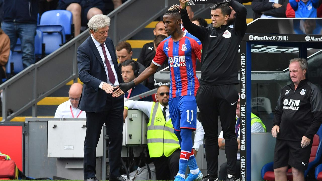 He's back: Crystal Palace's Ivorian striker Wilfried Zaha (C) ended his stoush with the club and played in their English Premier League opener. (Photo by Ben STANSALL / AFP)
