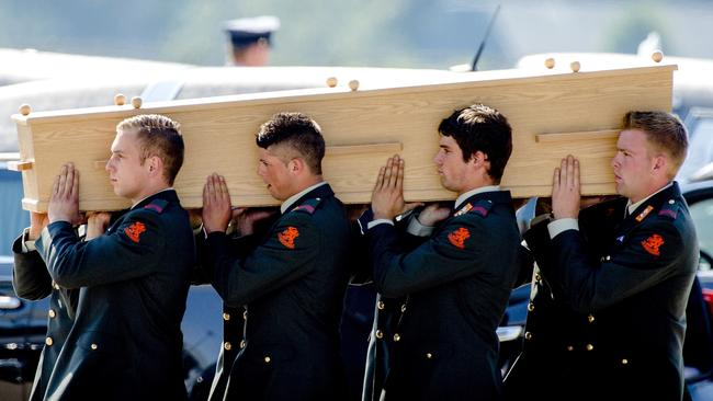 Dutch military men carry a coffin containing the remains of a victim of downed flight MH17. Picture: Robin van Lonkhuijsen