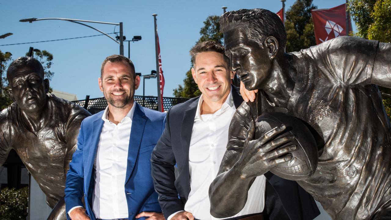 Melbourne Storm legends Cameron Smith and Billy Slater poses for a photo with their statues