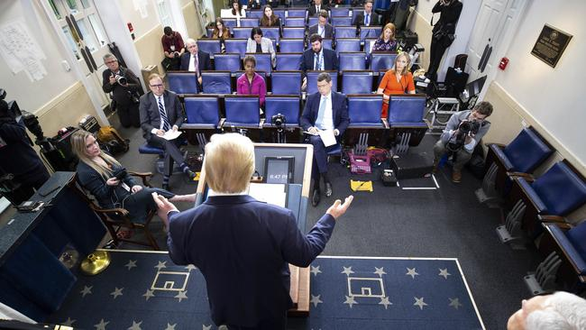 Mr Trump during today's briefing. Note the social distancing in the room. Picture: Alex Brandon/AP