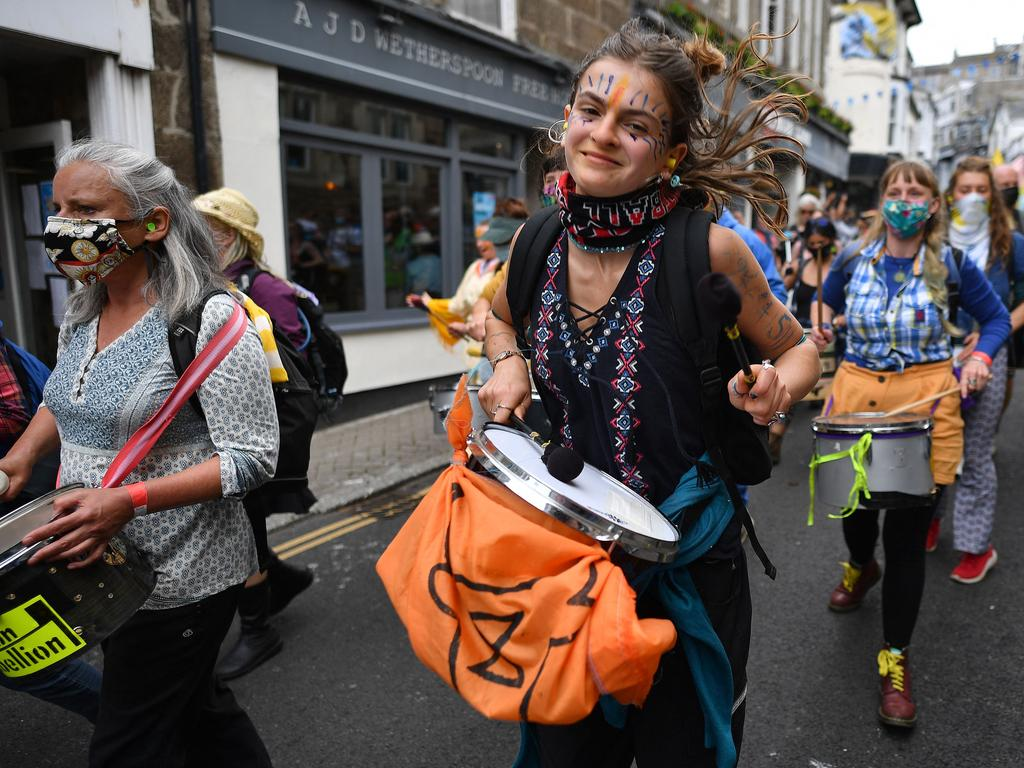 Activists take part in an Extinction Rebellion climate change protest march in St Ives, Cornwall.