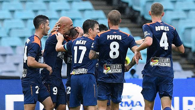 Brisbane Roar striker Massimo Maccarone (second left) celebrates with teammates after scoring against the Wanderers.