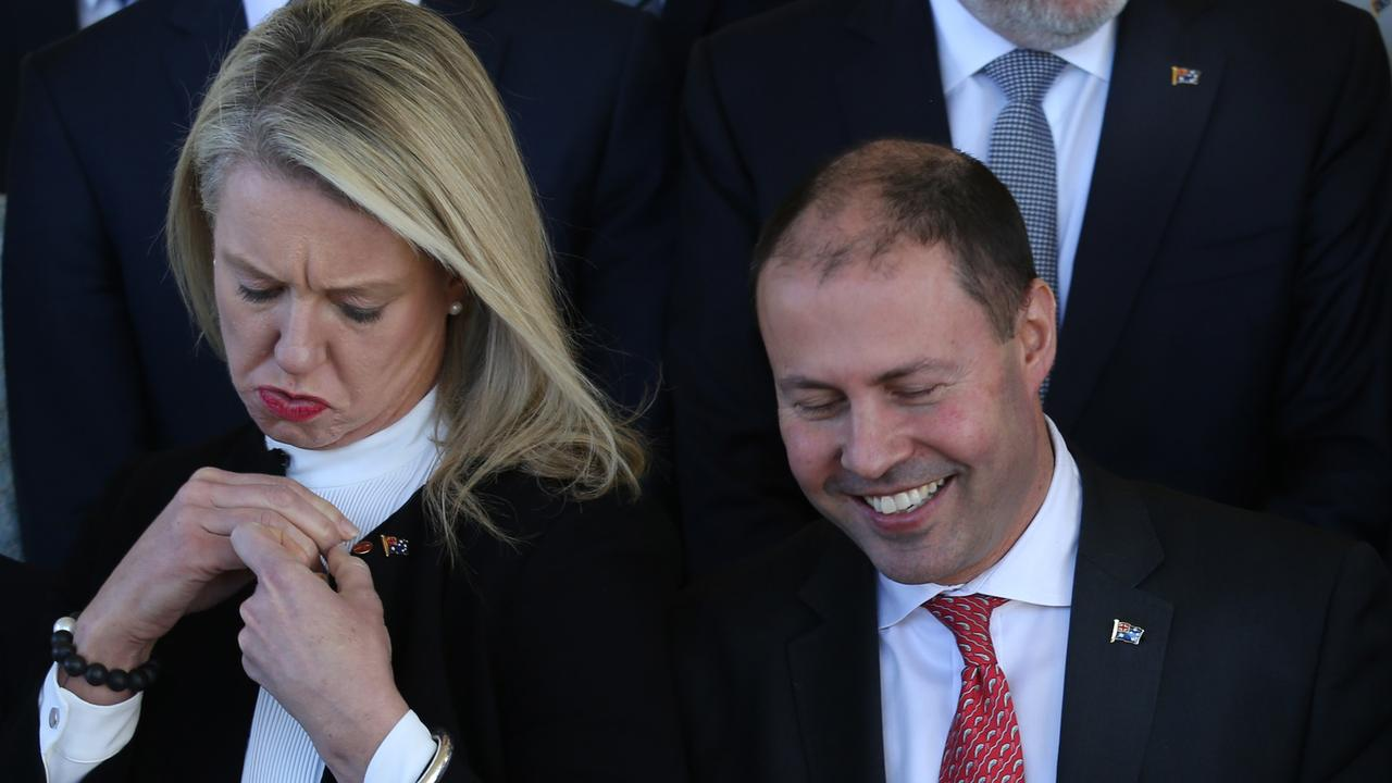 52cc62e324512 Bridget McKenzie with Treasurer Josh Frydenberg affix their new Aussie Flag  pins after being sworn in