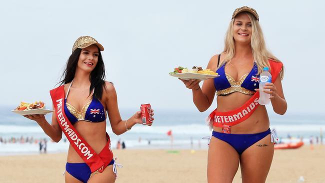 Brearna Newman and Jade Ellis on Surfers Paradise beach. Photo: Tim Marsden