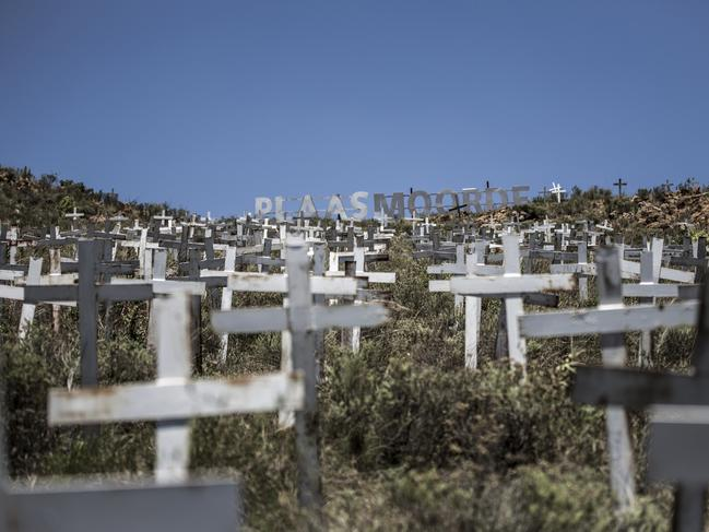 Crosses are planted on a hillside at the White Cross Monument, each one marking a white farmer who has been killed in a farm murder in Ysterberg, near Langebaan, South Africa. Picture: AFP