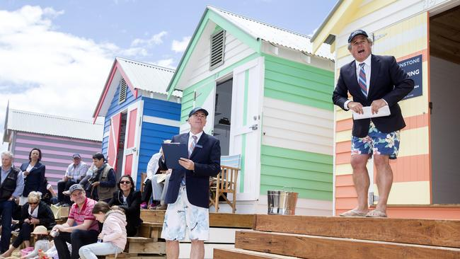 Nick Johnstone, of Nick Johnstone Real Estate, conducts a Brighton beach auction in board shorts in December 2016. Picture: Sarah Matray