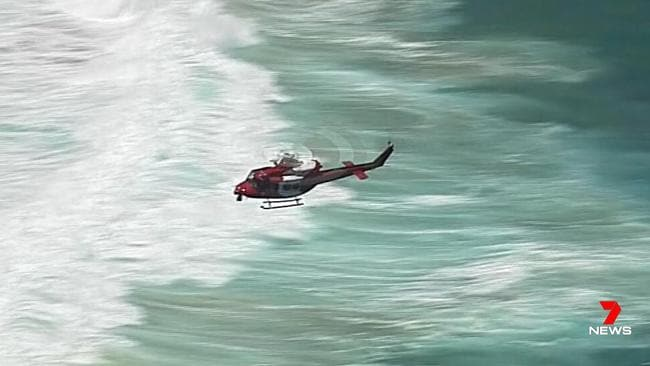 A helicopter searches for the missing man. Picture: 7News