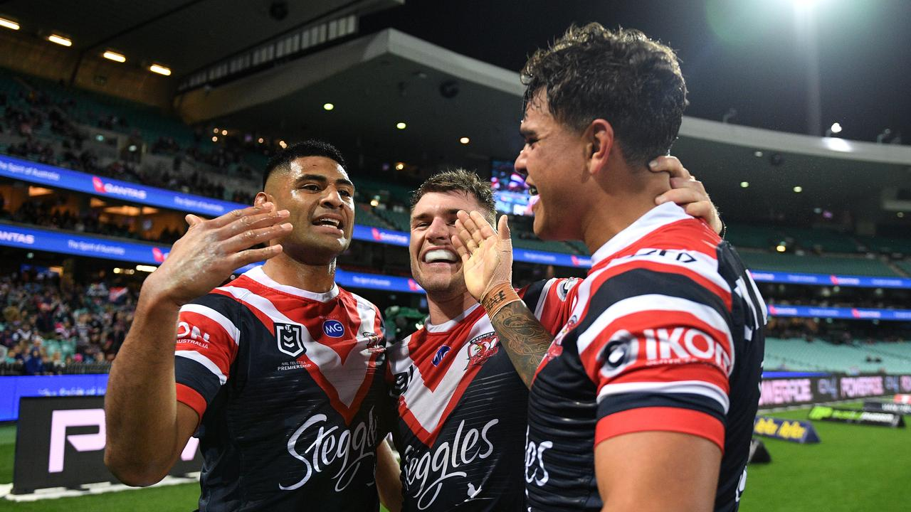 Daniel Tupou of the Roosters celebrates with Angus Crichton and Latrell Mitchell
