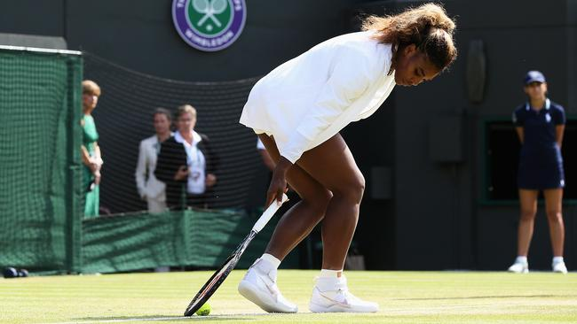 Williams struggles during the warm up prior her Ladies Doubles second round match.